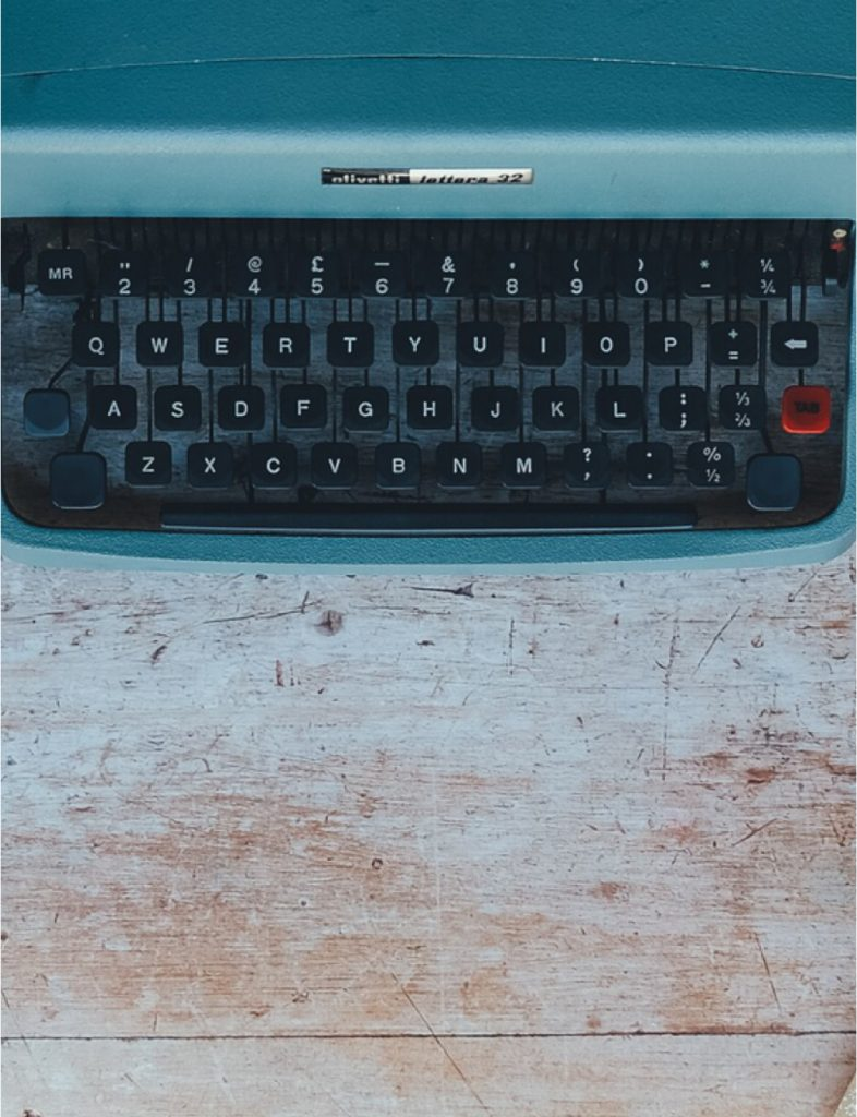 Contact us image of typewriter