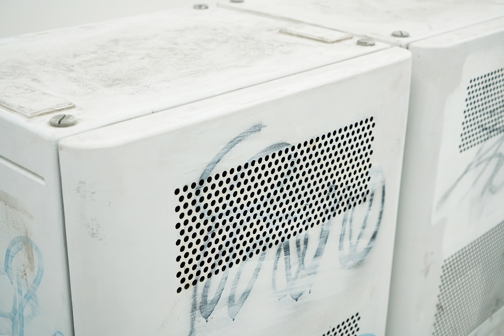 imposters artwork, a graffitid air conditioning unit
